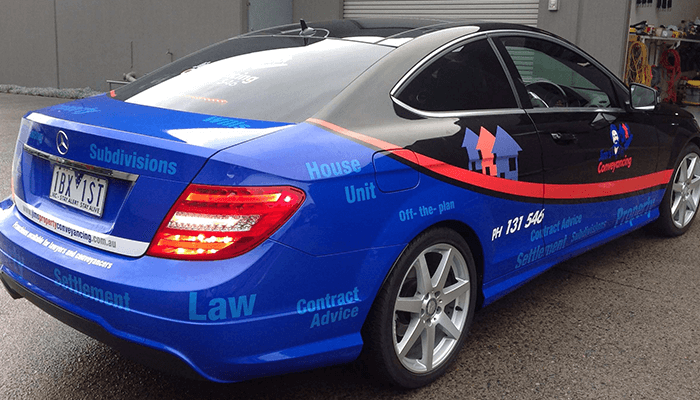 Vehicle wrap in vivid blue, red and black colours