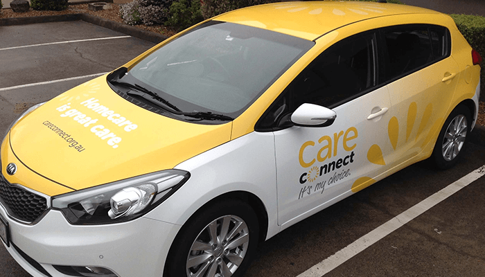 Yellow and white branded vehicle wrap by Colour Source